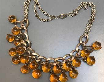 Vintage Pools of Light Amber Glass Necklace .   Art Deco   Jewelry