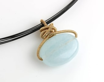 Aquamarine with Gold Fill Coils on Blackened Steel Neck Wire