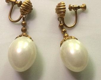 Dangling earrings, fancy beads and gold egg shape