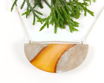 Orange and maple half moon necklace on sterling silver