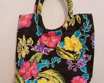 Canvas shoulder bag with tropical flower prints.