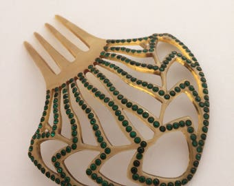 Clear watermarked celluloid Art Deco hair comb with green paste stones