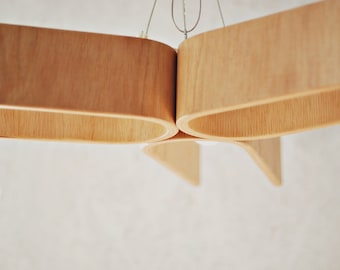 Hanging lamp from bent plywood