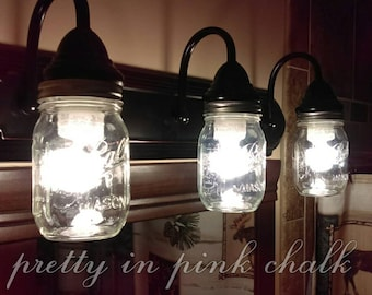 Mason jar 3 Light fixture!Perfect for your bathroom, vanity, etc. Rustic and country look! Lightening. Hanging lights. Oil rubbed bronze!
