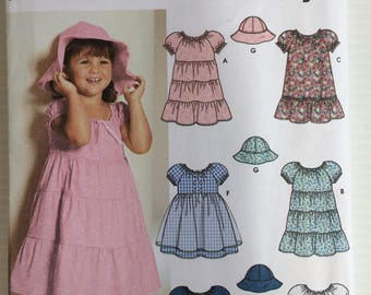 Simplicity sewing pattern 5695 - toddlers' dress and hat in size small, medium and large (2 -3 -4)