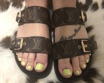 This weekend only... Sale.... Long awaited Louis Vuitton slides