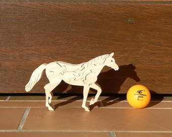 Carved wooden horse puzzle