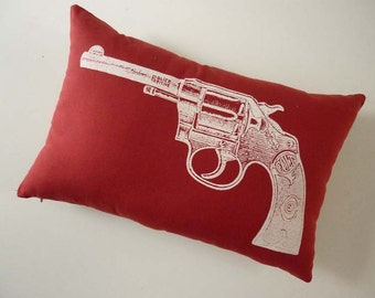 Colt Revolver silk screened cotton canvas throw pillow 12x18 red white