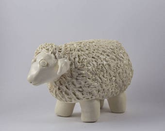 Naive ecru color, glossy clay sheep