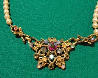 Just reduced Crazy ad stream vintage coro finding and new faux pearl necklace recycled