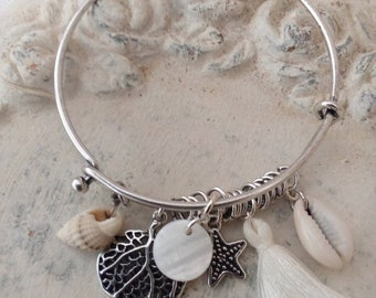 In shades of white charm bracelet