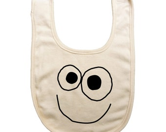 Organic cotton baby reversible bib with screen printed happy face design on the front and yum yum on the back by Bugged Out, made in the USA