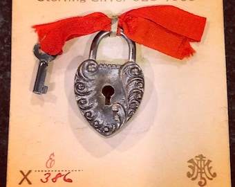Sterling silver padlock and key on original card