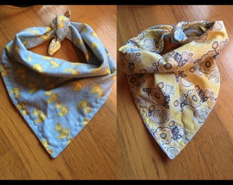 About 25 inch ducks and yellow paisley reversible tie on bandana