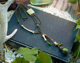 woodland necklace with bones, beads, and a moss-filled vial