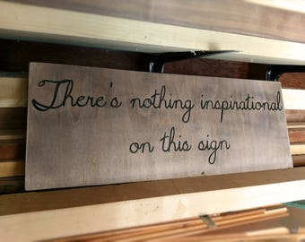 "Rustic ""Nothing inspirational"" wood sign"