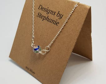 Vintage Upcycled Rainbow Glass Infinity Necklace. Minimalist Sterling Silver Necklace. Pretty Blue and Pink Crystal - Designs by Stephanie