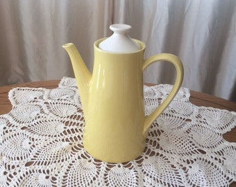 Yellow USA coffeepot with lid