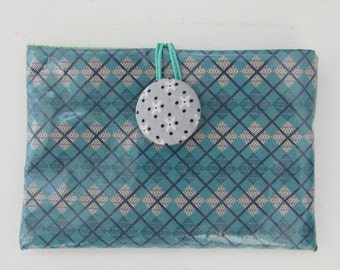 Blue coated canvas pouch.