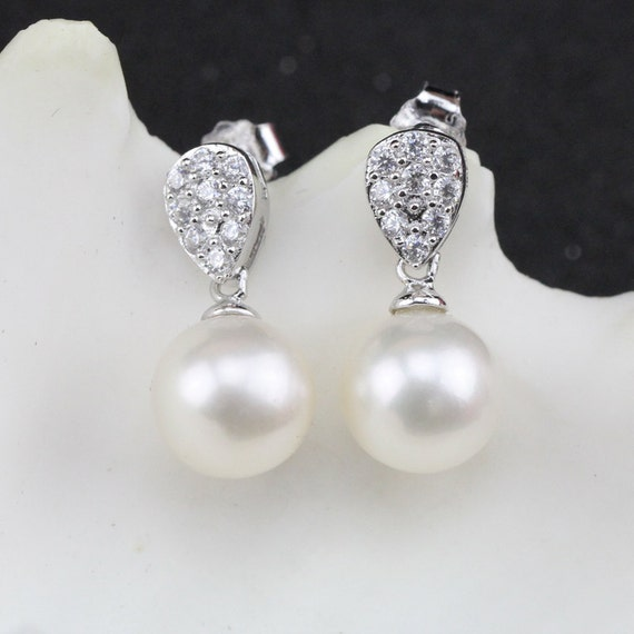 Perlen ohrringe tropfen hangend