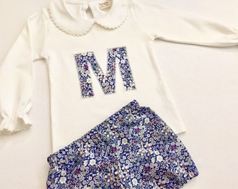 Top and bottom set. White collared top with Liberty applique and matching bloomers.