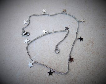 Fine chain (1 x 2 mm) silver color alloy steel - 41 cm covered stars 8 x 10 mm.