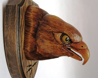 Falcon - the medallion trophy hunter. Handmade, wood carving.