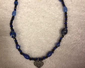 Blue glass necklace with heart charm