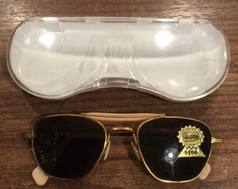 Vintage pink and gold sunglasses in original packaging