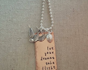 Let your dreams take flight Hand-stamped metal necklace, textured edges, pearl, swallow charm