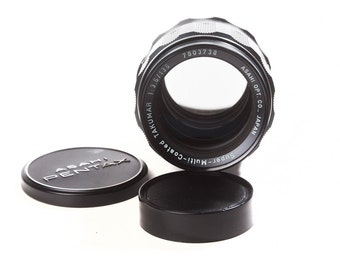 Super-Multi-Coated Asahi Pentax Takumar 135mm F3.5 portrait lens with hood. M42 screw mount.