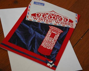 """Hand made Christmas card large 8""""x6"""" A5, featuring old school airmail envelope and intricately cut post box. Choose from navy or turquoise."""