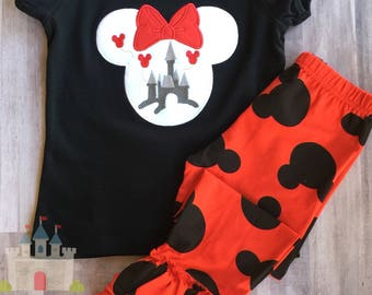 Minnie Mouse Silhouette with Cinderella's Castle on a Black Puff sleeve tee with Red and Black Mickey Head Ruffle Pants.