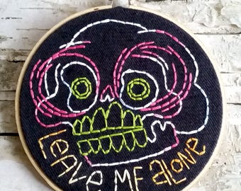 "pink & green LEAVE ME ALONE skull - 5"" hand embroidered wall hanging"