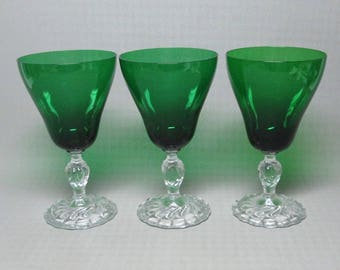"three glasses Anchor Hocking Burple water glass ? 6 1/2 "" high"