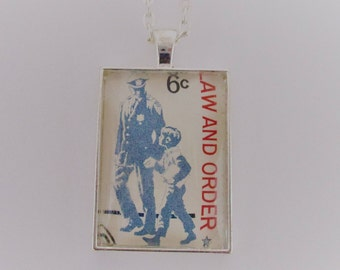 Policeman Postage Stamp Necklace, Policeman and Child Pendant, Law and Order Cancelled Postage Stamp Necklace, Stamp Jewelry, Police Gift