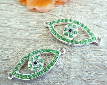 1 green eye in silver and rhinestone connector