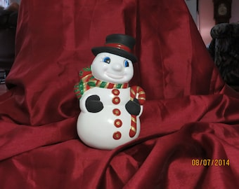 Snowman with his red cane