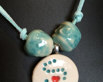 Beautiful Turquoise Blue, Handmade, Hand-rolled Porcelain Beads, Turquoise Blue Leather String, 'Cure for IBD' Logo Necklace.