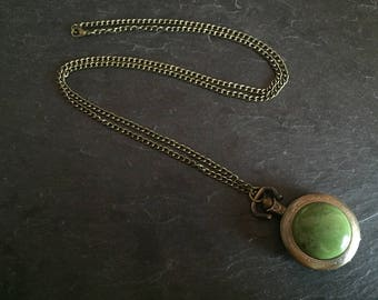 Necklace with a jade pocket watch.