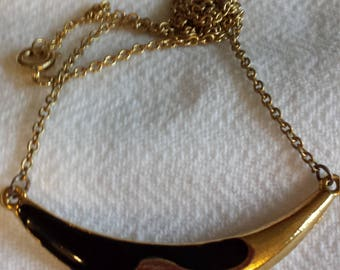 Ying and yang necklace.
