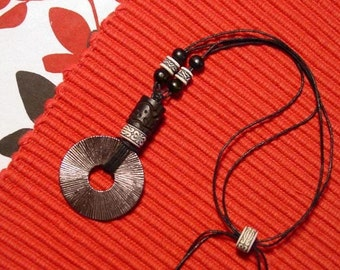 silver disc knotted necklace with black and white beads