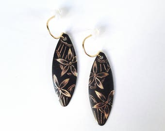 Blackened and etched brass earrings handmade with a floral reminiscent of lace