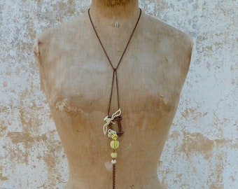 Dove Handmade French jewelry  ivory an Antique tiny yellow seed beads beaded beadwork on a frame