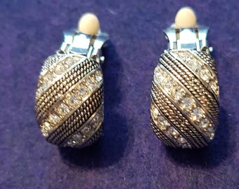 Vintage dressy clip on earrings with diagonal rows of pewter tone marcasite beaded texture alternating with rhinestones