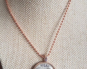 Sylko pendant / sewing theme gift / rose gold tone cabochon pendants / upcycled cotton thread labels / colour SEAL BROWN / oops