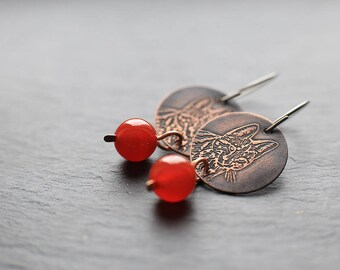 Dangle earrings with hypoallergenic titanium earwires: featuring etched servals on 22mm copper discs with 10mm red agate round beads