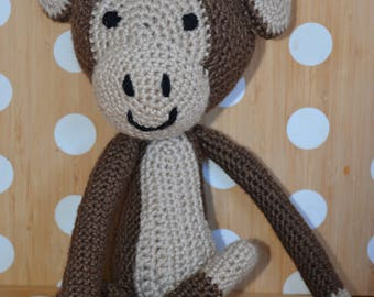 Crocheted amigurumi monkey stuffed animal toy