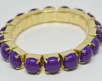 Gold tone and plastic stretchable bracelet
