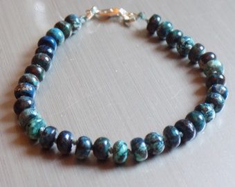 Chrysocolla buttons hand-knotted on pale green thread with a 925 sterling silver clasp.